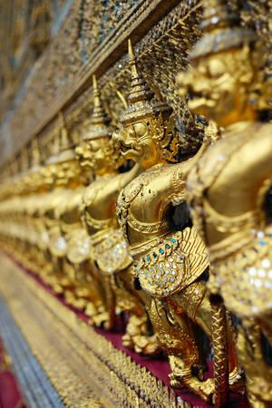 Golden garuda statues at Wat Phra Kaew in Grand Palace Bangkok Thailand photo