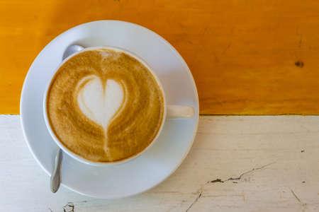 Cup of coffee on table in coffee shop. Foto de archivo