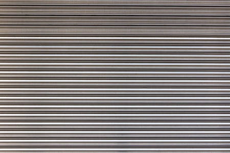 Texture of stainless roller shutter door the background  photo