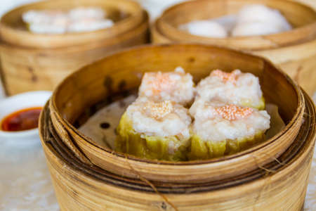 Chinese Streamed Dumpling in Bamboo Basket. photo