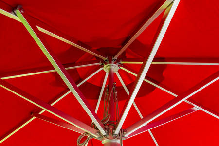 Red beach umbrella on a summer day. photo