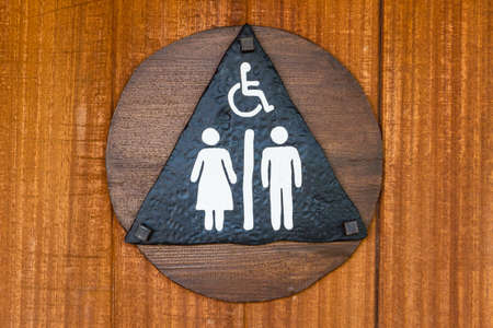 Toilet sign with wood background. Icon toilet. photo