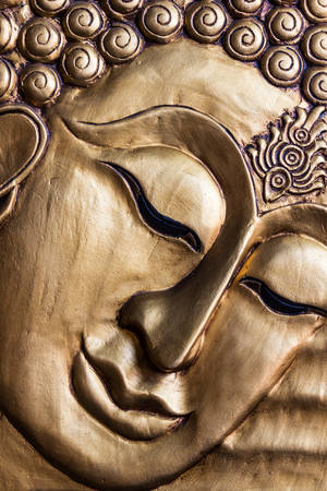 Close up Traditional Thai style Lord Buddhas face wood carving. Thailand