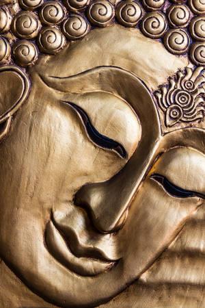 Close-up Traditionele Thaise stijl Boeddha's gezicht houtsnijwerk. Thailand Stockfoto