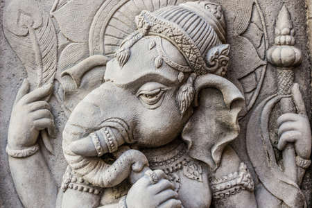 Close up ganesh hindu god face made from stucco work. Thailand.