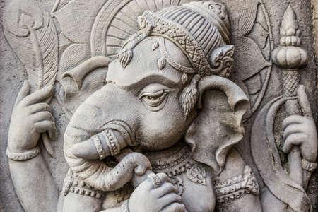 Close up ganesh hindu god face made from stucco work. Thailand.