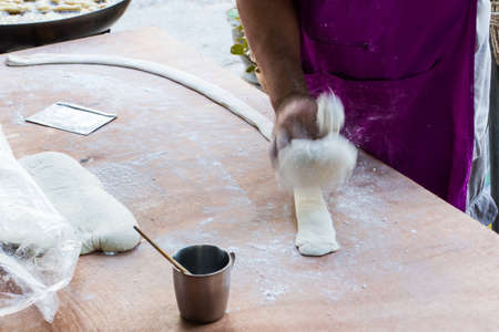 Threshing and cutting flour in process deep fried dough  photo