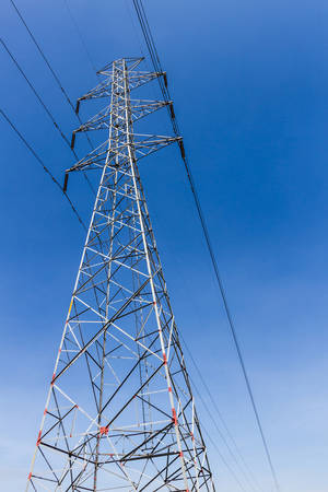 High-voltage tower on blue sky background.   photo