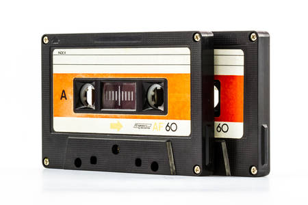 disuse: Closeup cassette tape isolate on white