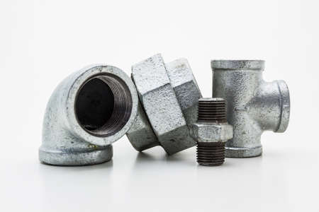 Iron pipe fittings for plumbing isolated on white background. Reklamní fotografie - 26569136