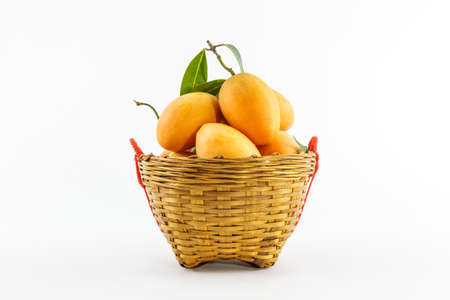Sweet Marian plum fruit in basket on white background photo