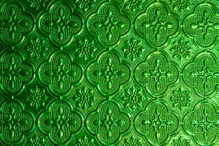 Pattern green window glass background in Thai style house. photo
