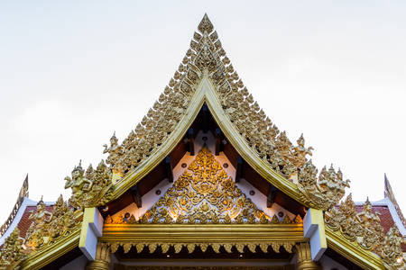 Ancient Thai temple,Thai classic arts Gable,Thailand photo