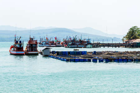 rearing of fish: Nice fishing boat  prepares before a fishing ,cage aquaculture farming,Thailand.  Stock Photo