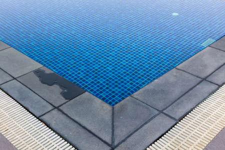 waterpool: The corner of swimming pool,Beautiful refreshing blue tiles pool