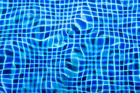 Swimming pool, Beautiful refreshing blue tiles pool with ripple water reflection as a summer background.  photo