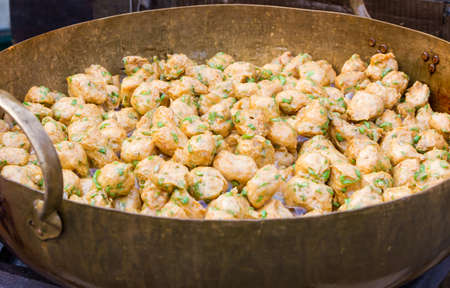 Thot man, Deep frying fish cake in boiling oil for sale in market,Thai cuisine. Stock Photo - 27656604