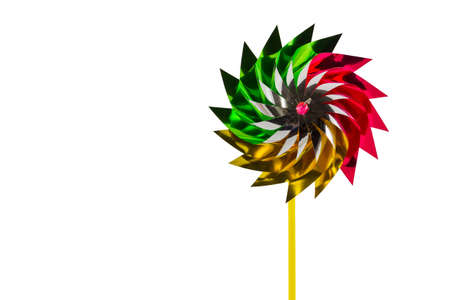 A multicolored pinwheel toy isolate white background. education, childhood and ecology concept. photo