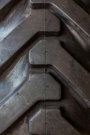 tire tread: Big tractor rubber tire tread texture background. Stock Photo