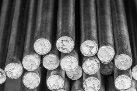 irony: Stack of round steel bar - iron metal rail lines material for industry construction.
