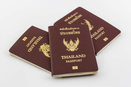 customs official: Closeup Thailand passport on white background.