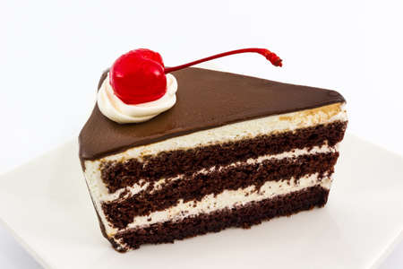 Chocolate cake slice with red cherry fruit. photo