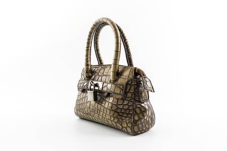 designer bag: Brown Leather Ladies Handbag isolated on white background.