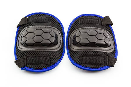 blader: Knee pads of knee protectors on white background. Stock Photo