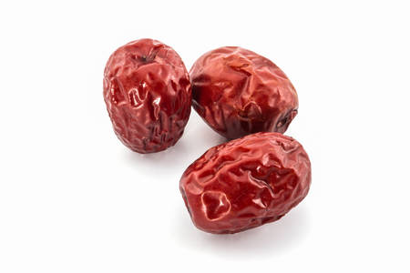 Dried Red chinese jujube on white background.