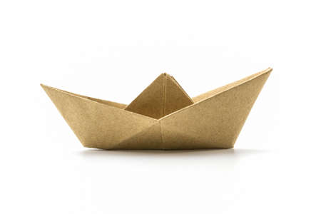 Paper origami brown boat on the white background.