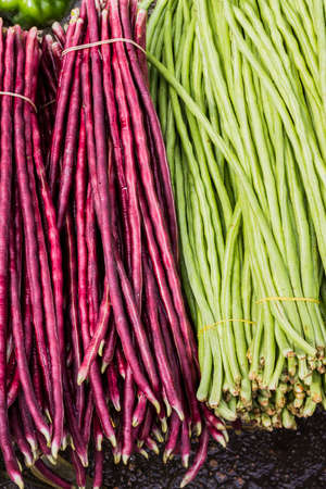 Fresh green and red beans for sale in a market. Stock Photo - 29028054