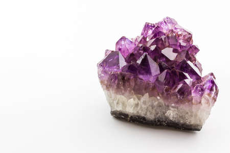 Crystal Stone, purple rough amethyst crystals on white background. photo