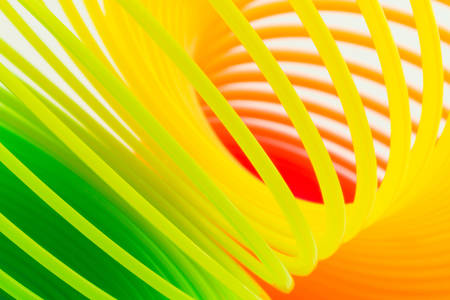 resilient: Close up rainbow colored wire spiral. Stock Photo