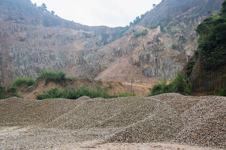 Limestone Quarry, Piles of limestone rocks in China. photo