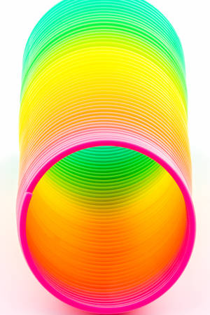 Rainbow colored wire spiral on white background  photo