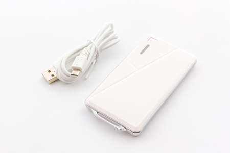 recharge: White Power bank, small device that have electricity to recharge many kind of smart phone via USB.
