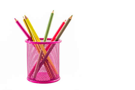 Colorful pencils in pink pail on white background.  photo