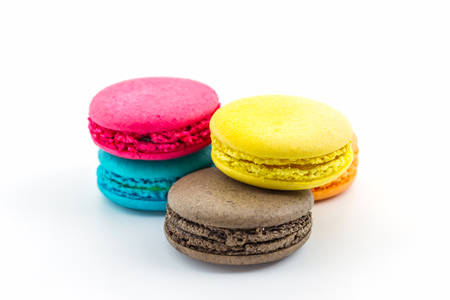 Sweet and colourful french macaroons on white background, Dessert. photo