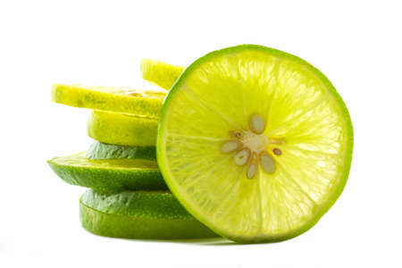 Group of fresh lime slices on white background.