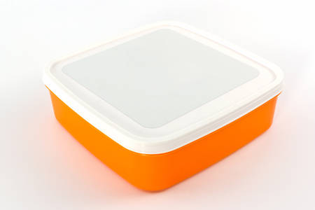 homeware: Plastic box package on white background.