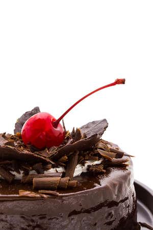 Closeup chocolate cake with red cherry fruit. photo