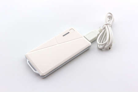 recharge: White Power bank, small device that have electricity to recharge many kind of smart phone via USB.  Stock Photo