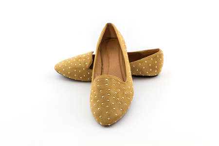 Brown flat shoes on white background.  photo