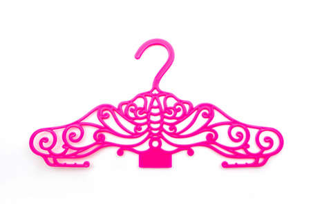 Pink of vintage plastic hanger clothes on white background. photo