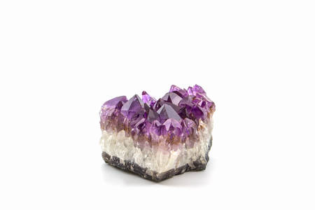 Crystal Stone, purple rough amethyst crystals on white background.  Imagens