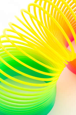 Rainbow colored wire spiral on white background.  photo