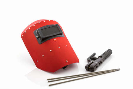 implements: Red protective screen and rod-holder with Welding electrodes wire, for electric arc welding, on white background.