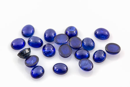 dazzlingly: Close up Blue sapphire on white background. Stock Photo