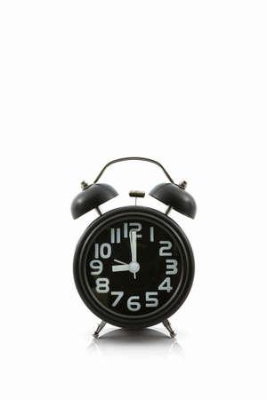 Black old fashion alarm clock on white background. Reklamní fotografie