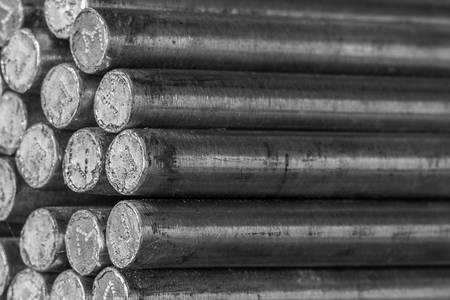 Stack of round steel bar - iron metal rail lines material for industry construction.  photo